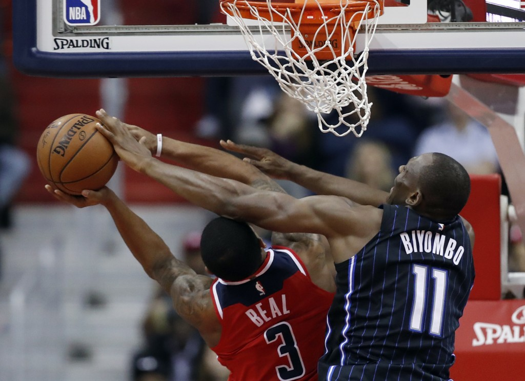 Washington Wizards guard Bradley Beal (3) is fouled by Orlando Magic center Bismack Biyombo (11) during the first half of an NBA basketball game Frida
