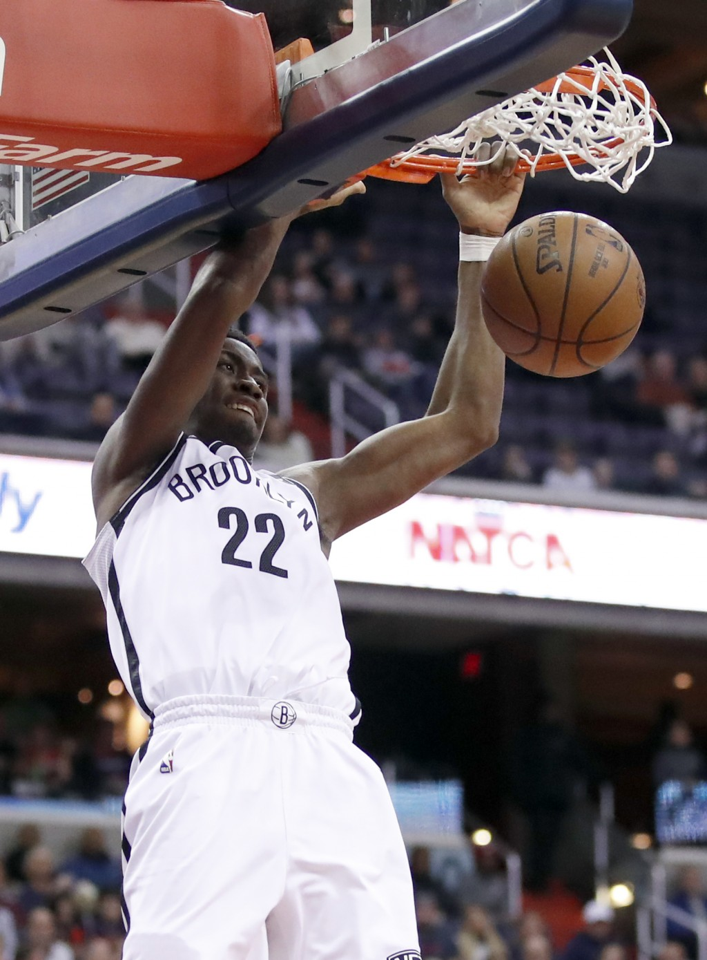 Brooklyn Nets guard Caris LeVert (22) dunks the ball during the first half of an NBA basketball game against the Washington Wizards, Saturday, Jan. 13