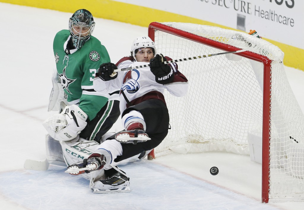 Colorado Avalanche center Alexander Kerfoot (13) stumbles in front of the net after score a goal against Dallas Stars goaltender Ben Bishop (30) durin