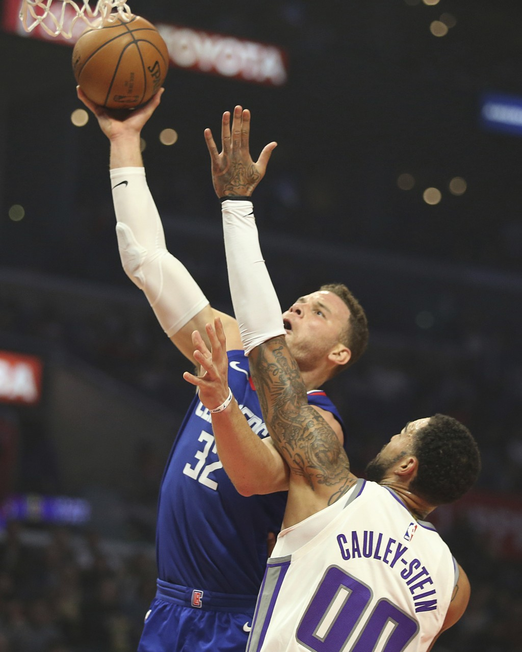 Sacramento Kings center Willie Cauley-Stein (00) fouls Los Angeles Clippers forward Blake Griffin (32) in the first period of an NBA basketball game i