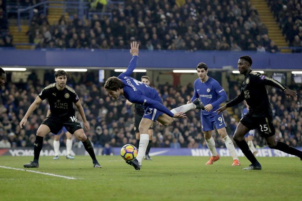 Chelsea's Marcos Alonso controls the ball with Leicester City's during the English Premier League soccer match between Chelsea and Leicester City at S
