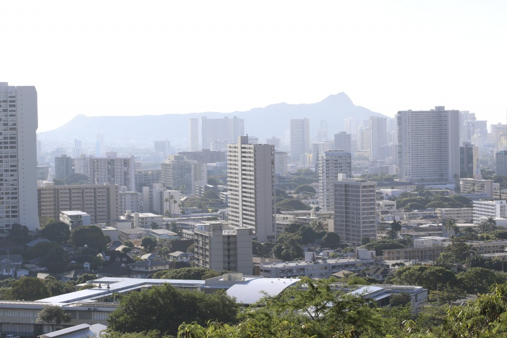 Diamond Head, an extinct volcanic crater, and high-rises are seen in Honolulu on Saturday, Jan. 13, 2018. A push alert that warned of an incoming ball