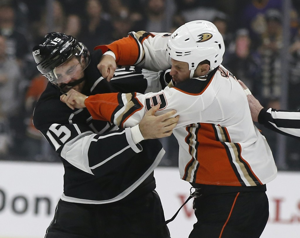 Anaheim Ducks defenseman Kevin Bieksa, right, fights with Los Angeles Kings left wing Andy Andreoff during the first period of an NHL hockey game in L