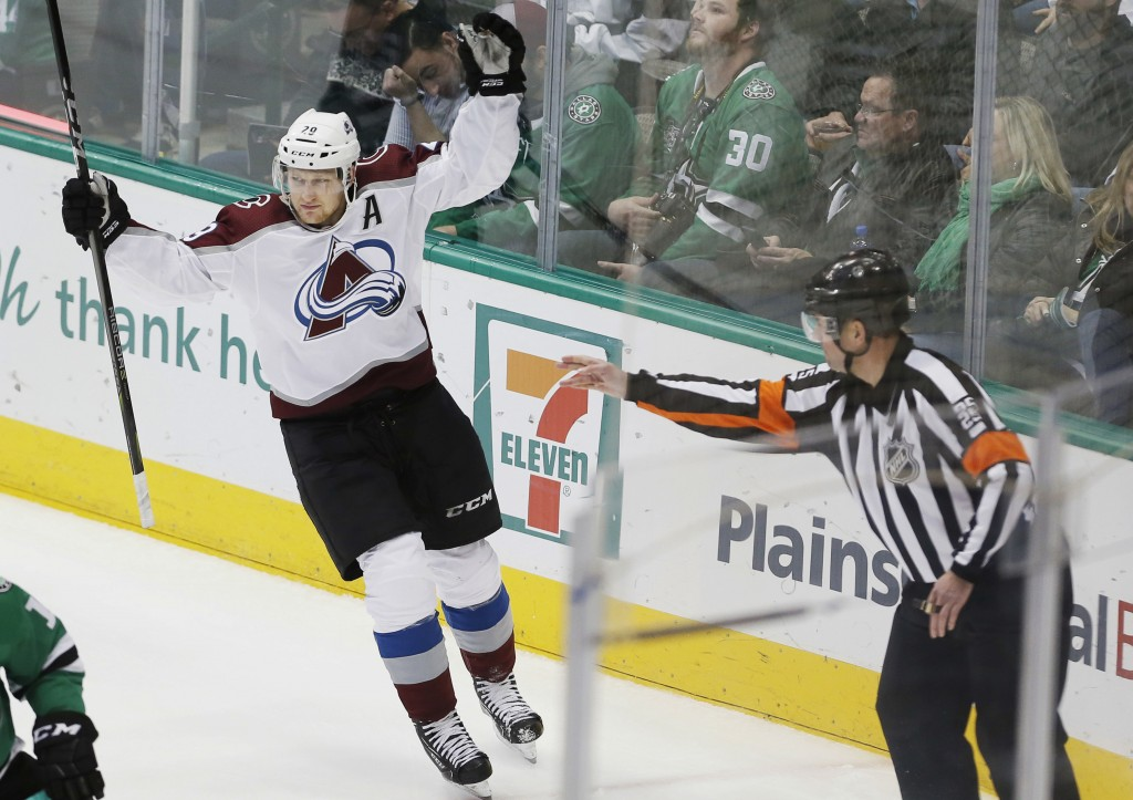 Colorado Avalanche forward Nathan MacKinnon celebrates his goal during the third period of an NHL hockey game against the Dallas Stars, Saturday, Jan.