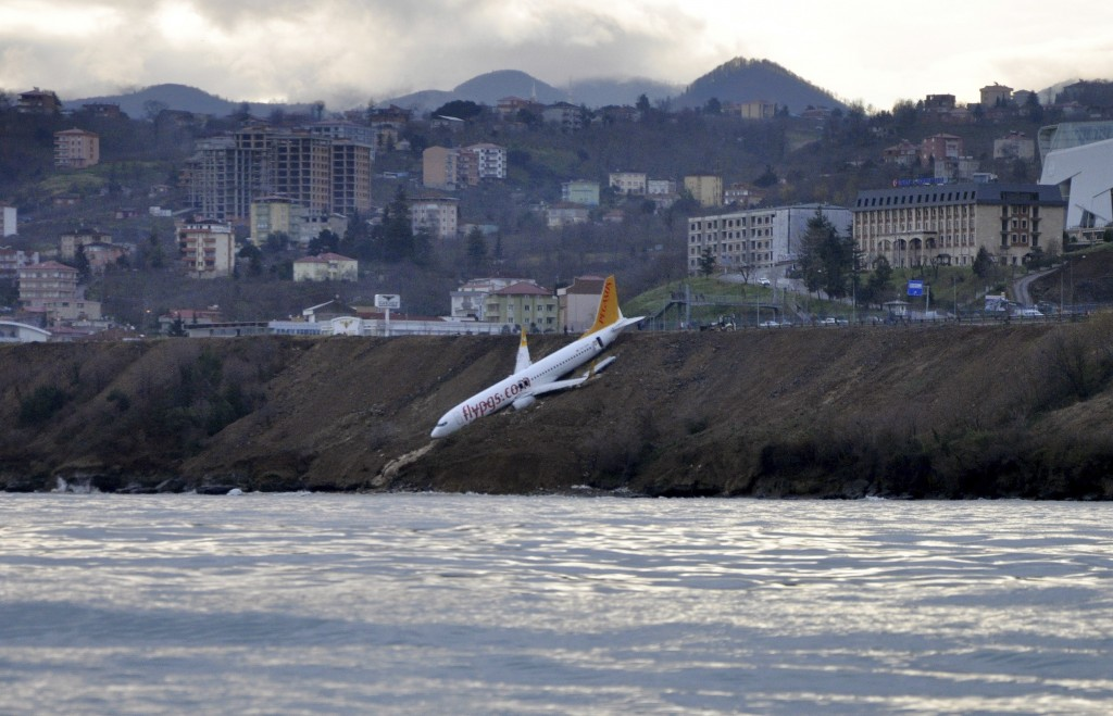 A Boeing 737-800 of Turkey's Pegasus Airlines after skidding off the runway downhill towards the sea at the airport in Trabzon, Turkey, Sunday, Jan. 1