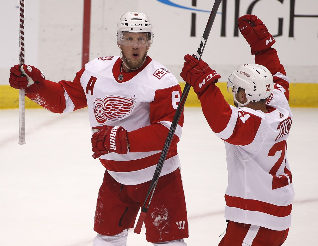 Detroit Red Wings' Justin Abdelkader (8) celebrates his goal with Tomas Tatar (21) in the first period of an NHL hockey game against the Pittsburgh Pe