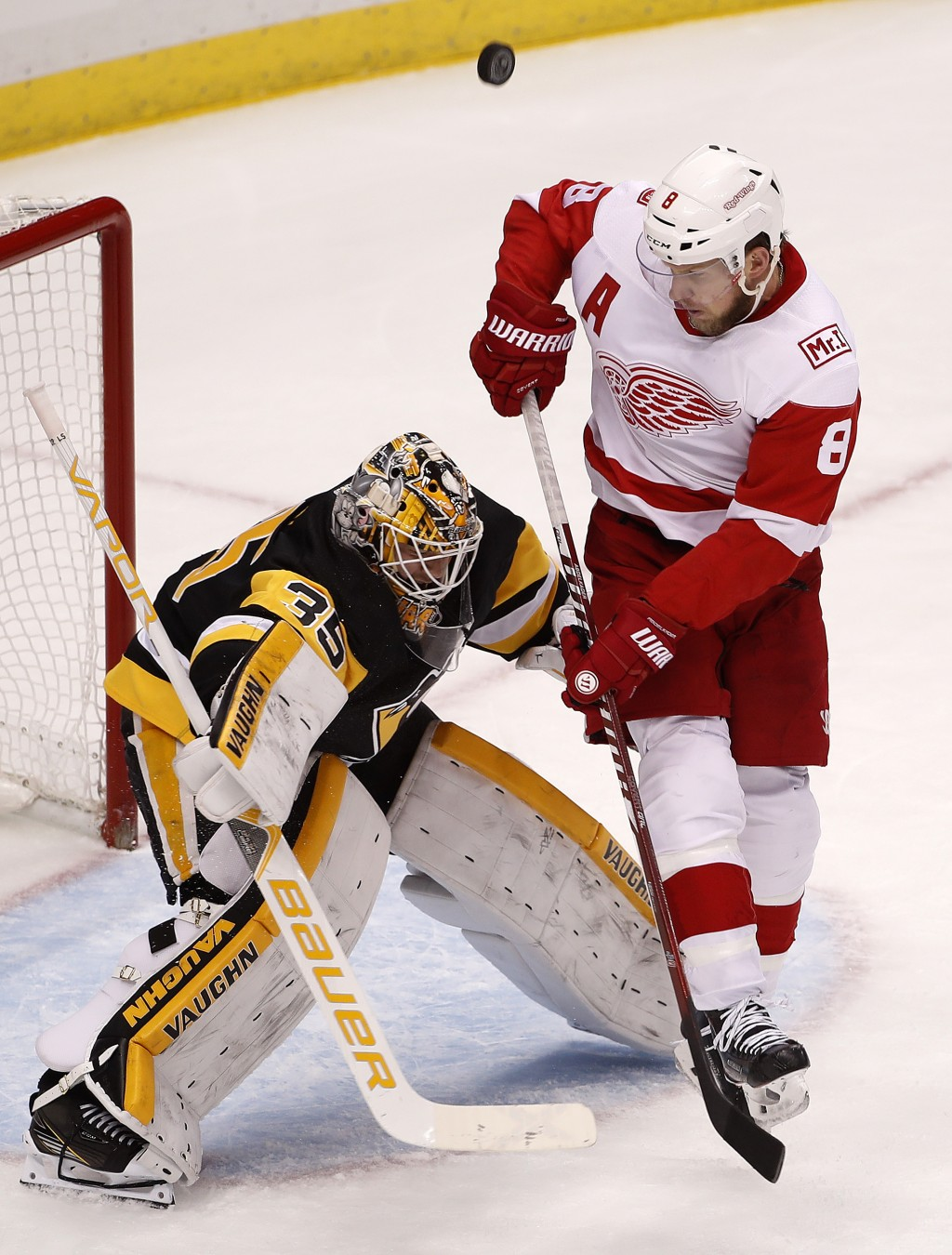 Pittsburgh Penguins goaltender Tristan Jarry (35) blocks a shot with Detroit Red Wings' Justin Abdelkader (8) screening him during the first period of