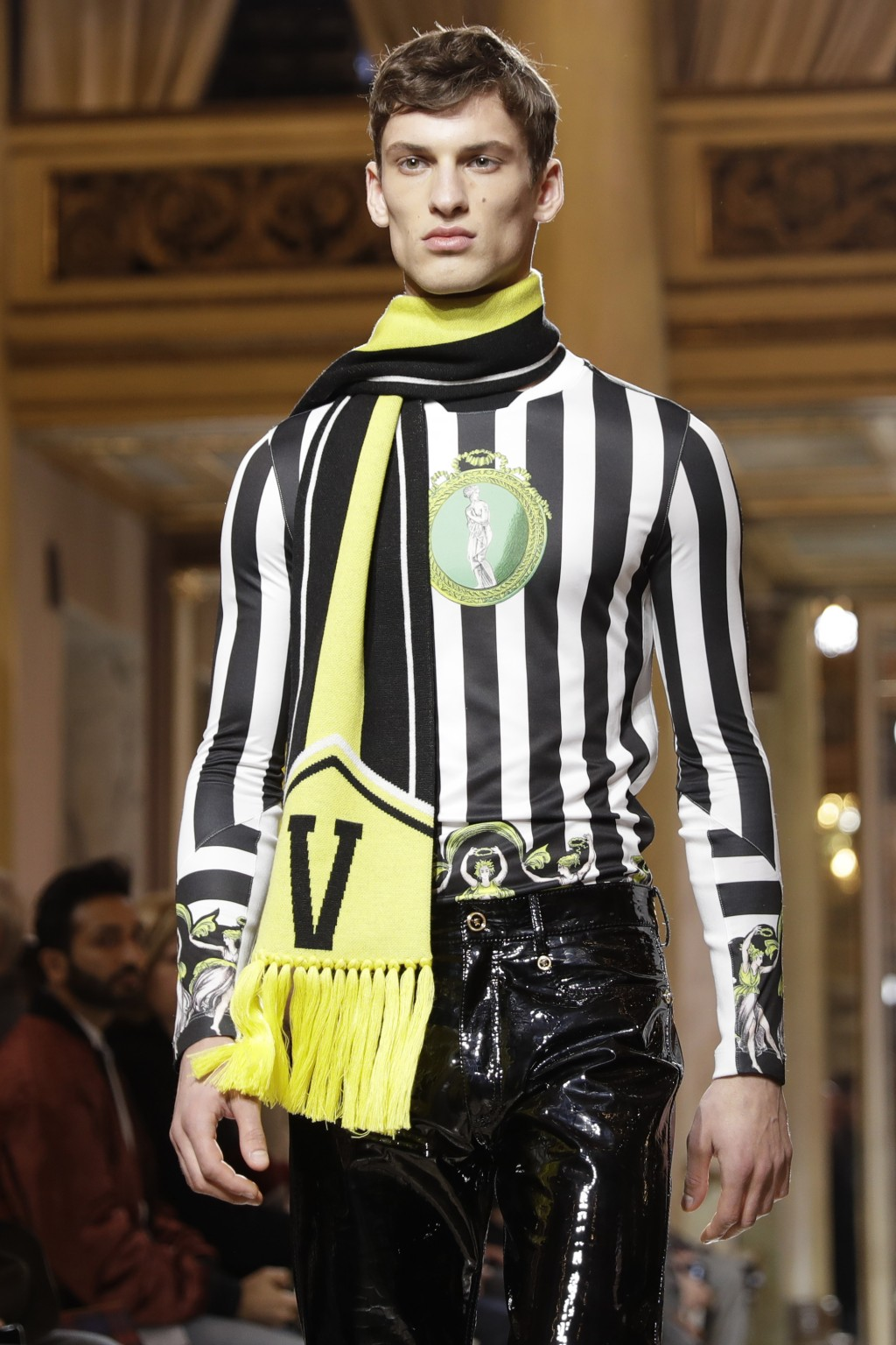 A model wears a creation as part of Versace men's Fall-Winter 2018-19 collection, that was presented in Milan, Italy, Saturday, Jan.13, 2018. (AP Phot