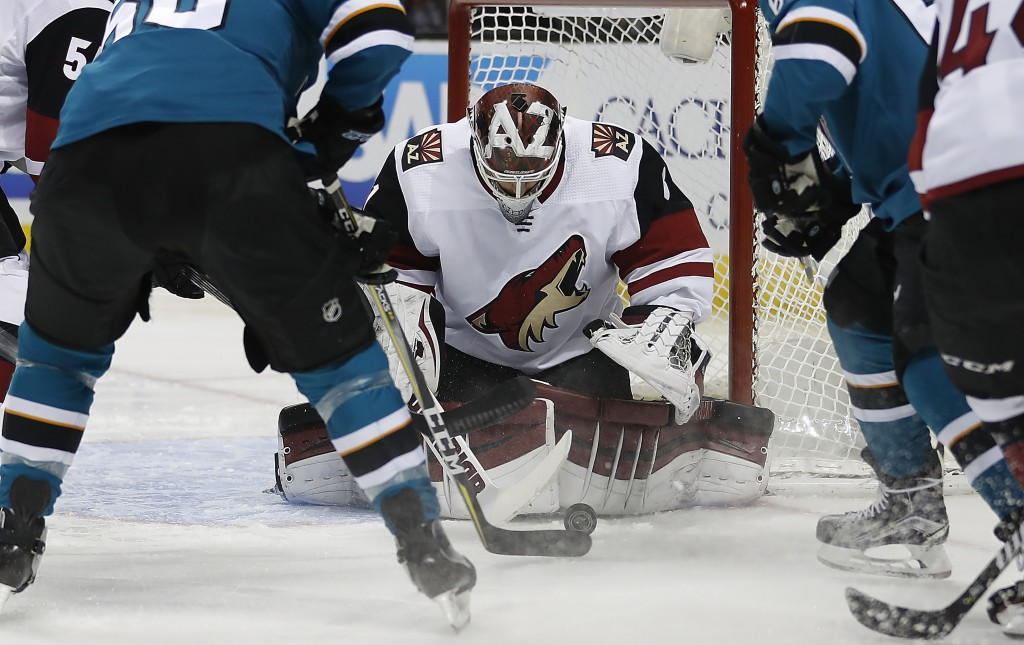 Arizona Coyotes goaltender Scott Wedgewood (31) blocks a shot at goal by the San Jose Sharks during the first period of an NHL hockey game Saturday, J