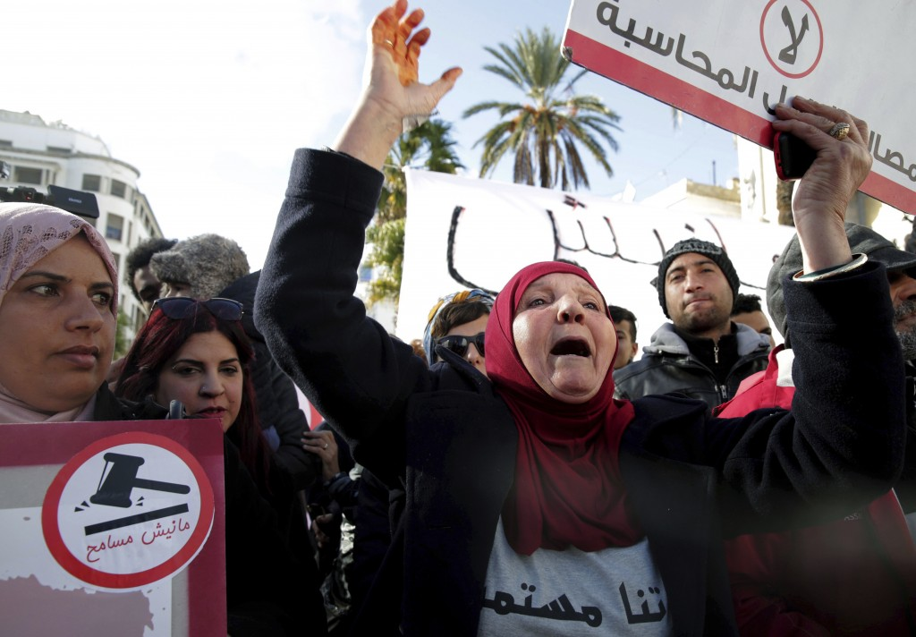 Family members of Tunisian who died in the revolution seven years ago, stage a protest in Tunis, Tunisia, Saturday, Jan. 13, 2018. European government