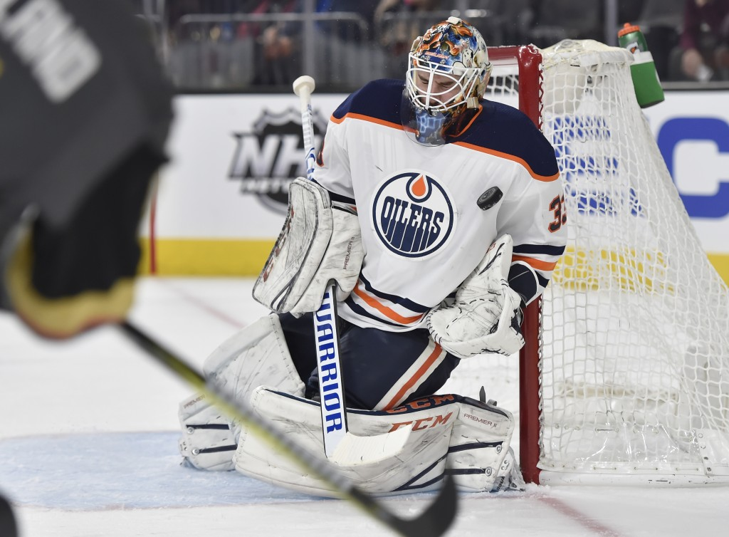 Edmonton Oilers goalie Cam Talbot (33) blocks a shot by the Vegas Golden Knights during the second period of an NHL hockey game Saturday, Jan. 13, 201