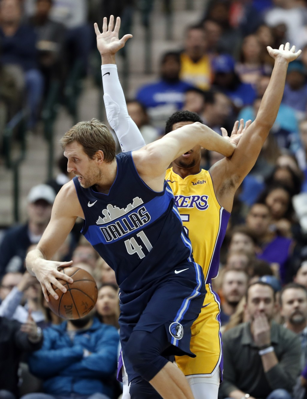 Dallas Mavericks forward Dirk Nowitzki (41) of Germany is fouled driving to the basket by Los Angeles Lakers' Josh Hart, rear, in the first half of an