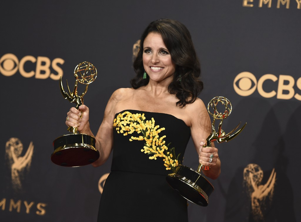 FILE - In this Sunday, Sept. 17, 2017 file photo, Julia Louis-Dreyfus poses in the press room with her awards for outstanding lead actress in a comedy