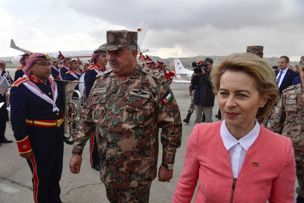 German Defence Minister Ursula von der Leyen, right, and Jordanian Chairman of the Joints Chief of Staff Mahmoud Freihat, center, attend a ceremony ha