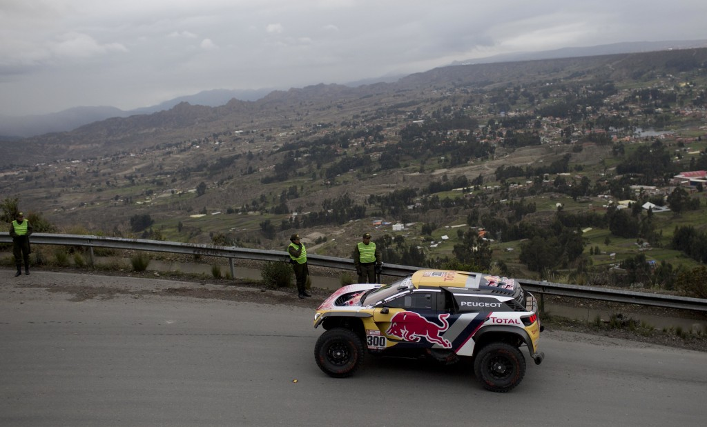 Peugeot driver Stephane Peterhansel and co-driver Jean Paul Cottret, both of France, depart from La Paz, Bolivia, for the Dakar Rally stage 7 on Satur