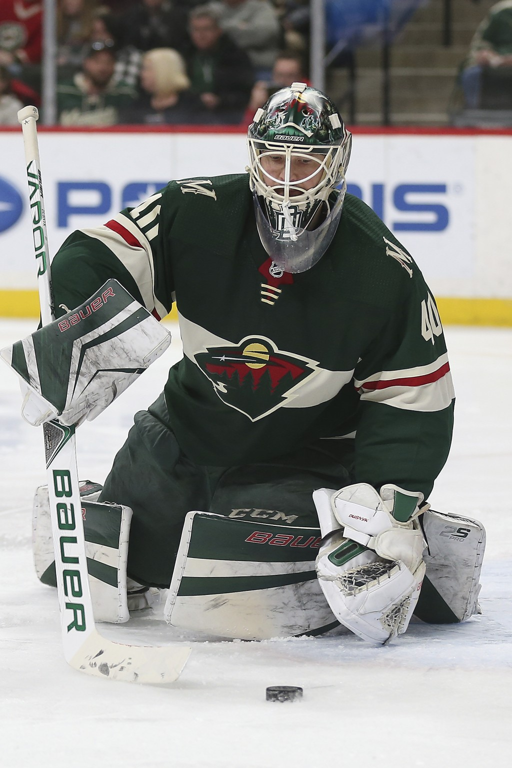 Minnesota Wild's goalie Devan Dubnyk (40) watches the puck in the second period of an NHL hockey game against the Winnipeg Jets, Saturday, Jan. 13, 20