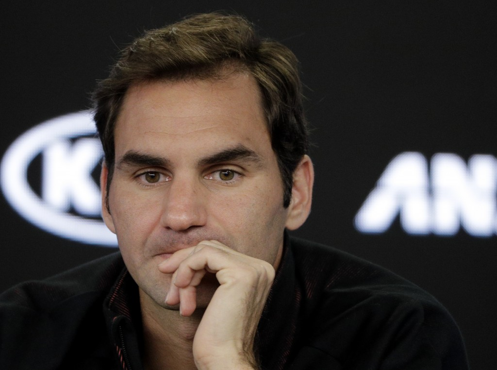 Switzerland's Roger Federer answers questions during a press conference at the Australian Open tennis championships in Melbourne, Australia, Sunday, J