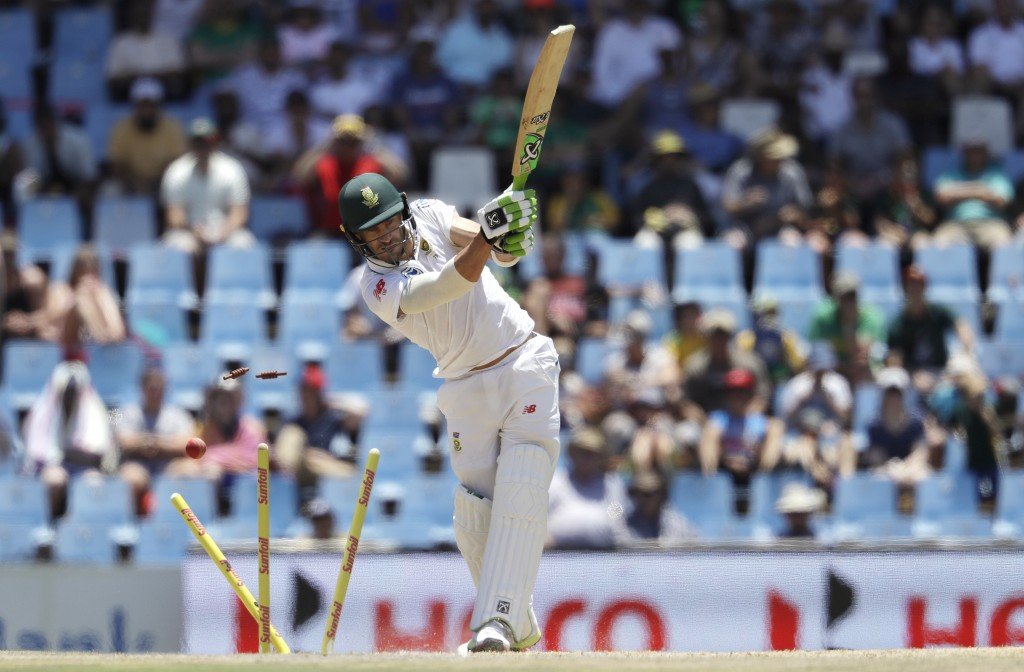 South Africa's captain Faf du Plessis' is bowled by India's bowler Ishant Sharma, for 63 runs during the second day of the second cricket test match b