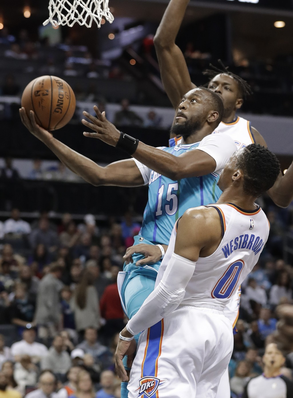 Charlotte Hornets' Kemba Walker (15) drives past Oklahoma City Thunder's Russell Westbrook (0) during the first half of an NBA basketball game in Char