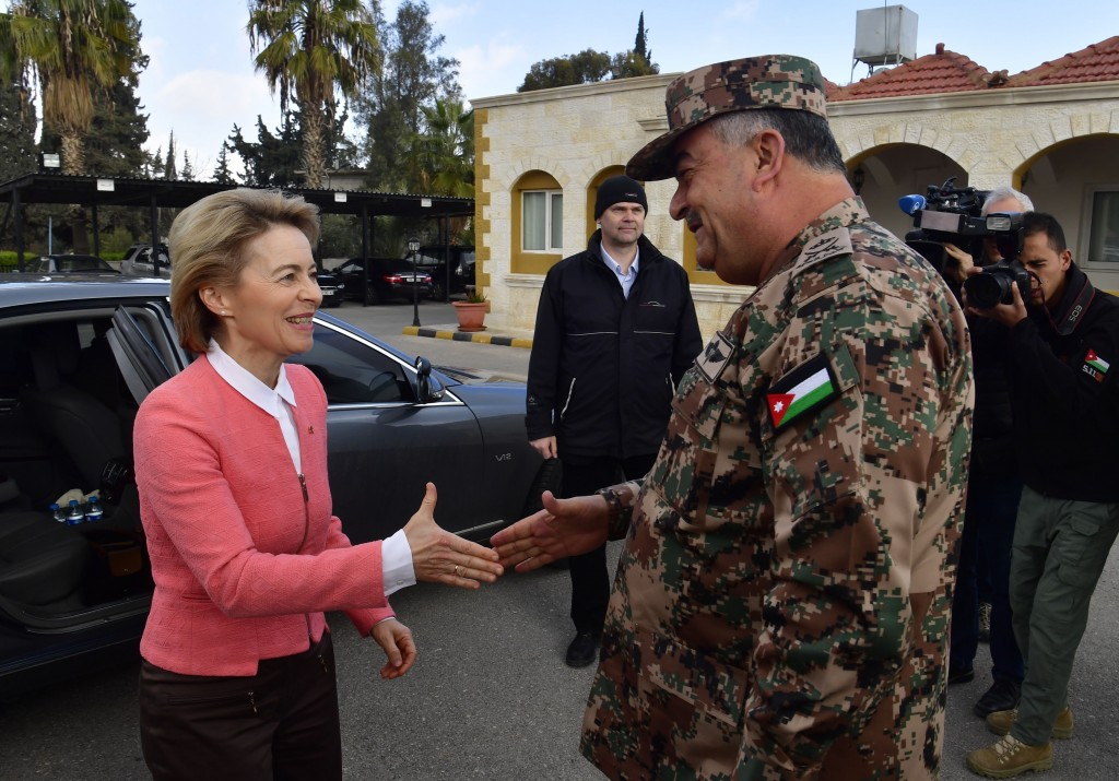German Defense Minister Ursula von der Leyen, left, is greeted by Jordanian Chairman of the Joints Chief of Staff Mahmoud Freihat prior to a handing o
