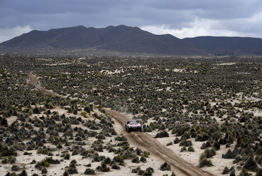 Driver Carlos Sainz, of Spain, and co-driver Lucas Cruz, of Spain, race their Peugeot during stage 7 of the 2018 Dakar Rally between La Paz and Uyuni,
