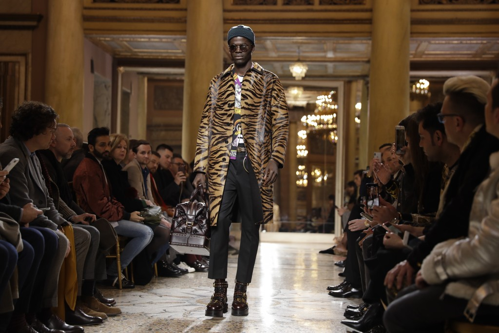 A model wears a creations as part of Versace men's Fall-Winter 2018-19 collection, that was presented in Milan, Italy, Saturday, Jan.13, 2018. (AP Pho