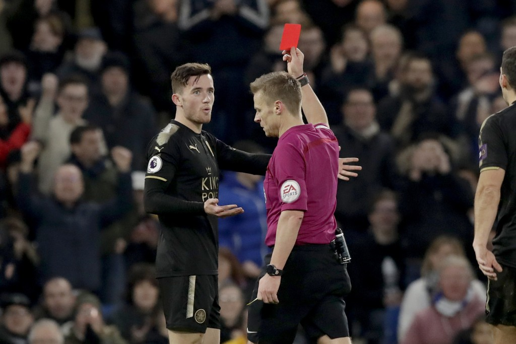 Leicester City's Ben Chilwell is given a red card after receiving two yellows during the English Premier League soccer match between Chelsea and Leice