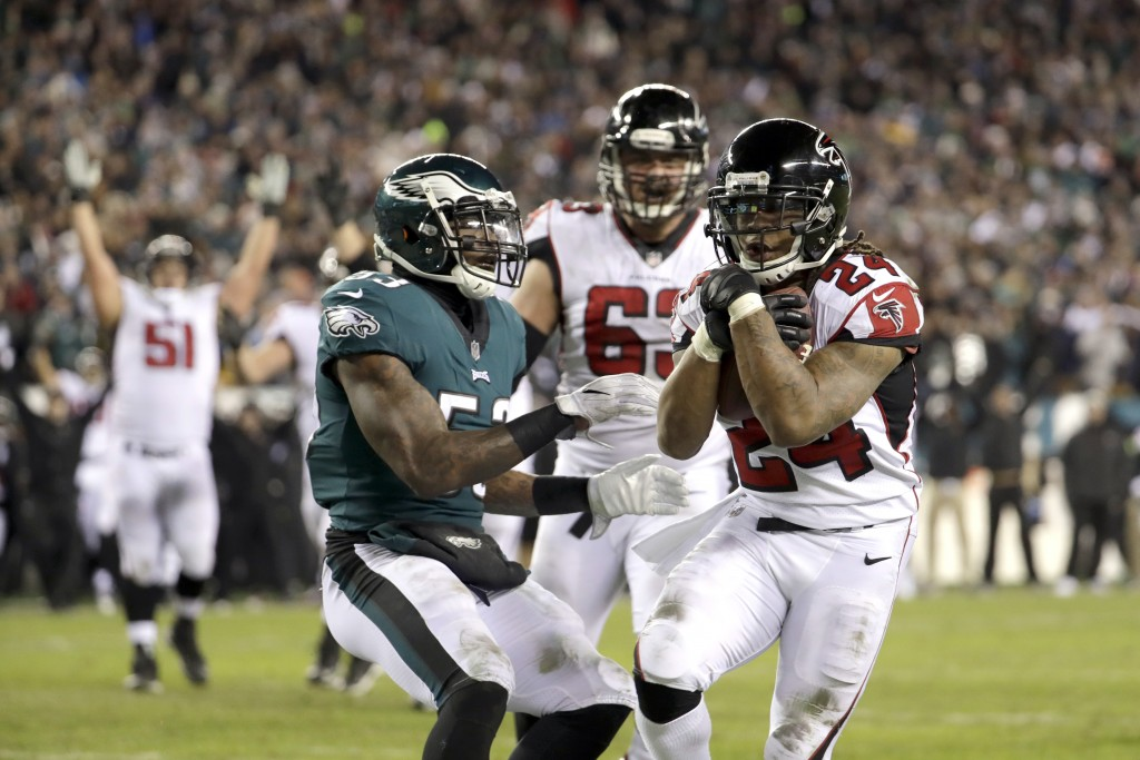 Atlanta Falcons' Devonta Freeman (24) scores a touchdown against Philadelphia Eagles' Nigel Bradham (53) during the first half of an NFL divisional pl