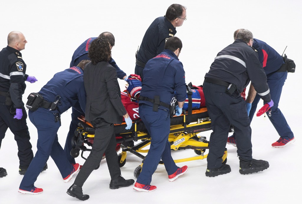 Montreal Canadiens' Phillip Danault is stretchered off the ice after he was hit in the head by a puck on a shot by Boston Bruins' Zdeno Chara during s