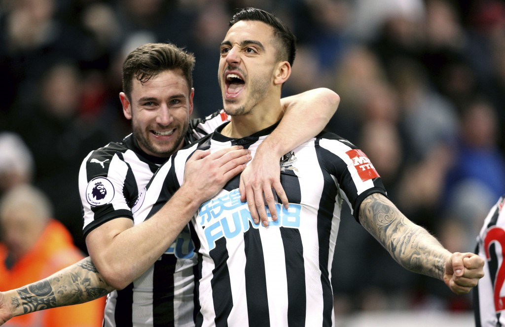 Newcastle United's Joselu, right, celebrates scoring his side's first goal of the game with team mate Paul Dummett during the English Premier League s