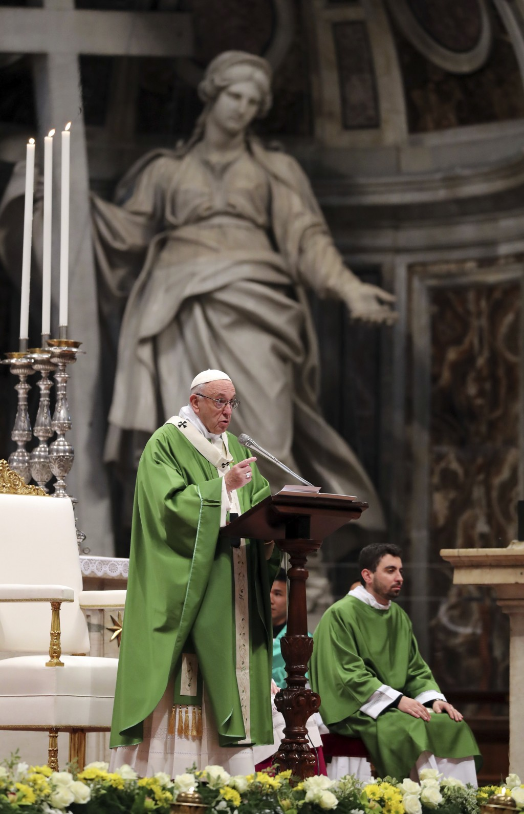 Pope Francis celebrates Mass on the occasion of the world day for migrants and refugees, in St. Peter's Basilica at the Vatican, Sunday, Jan. 14, 2018