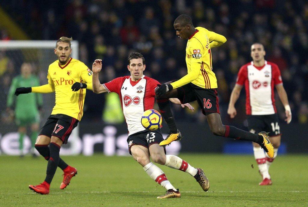 Watford's Abdoulaye Doucoure, right, battles for the ball with Southampton's Pierre-Emile Hojbjerg during the English Premier League soccer match at V