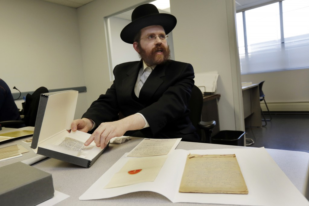 In this Wednesday Jan. 10, 2018, photo, Dovid Reidel, Director of Research & Archive Division of the Amud Aish Memorial Museum, in Brooklyn, N.Y., sho