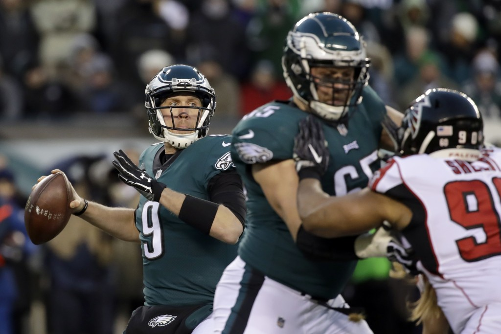 Philadelphia Eagles' Nick Foles in action during the first half of an NFL divisional playoff football game against the Atlanta Falcons, Saturday, Jan.