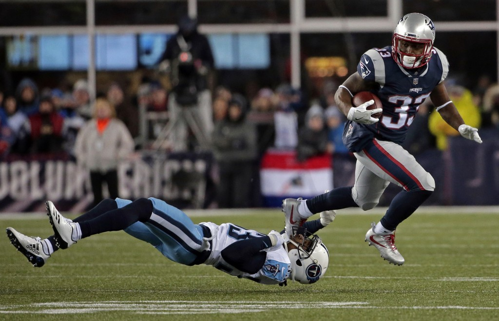 New England Patriots running back Dion Lewis, right, eludes Tennessee Titans cornerback Tye Smith during the first half of an NFL divisional playoff f