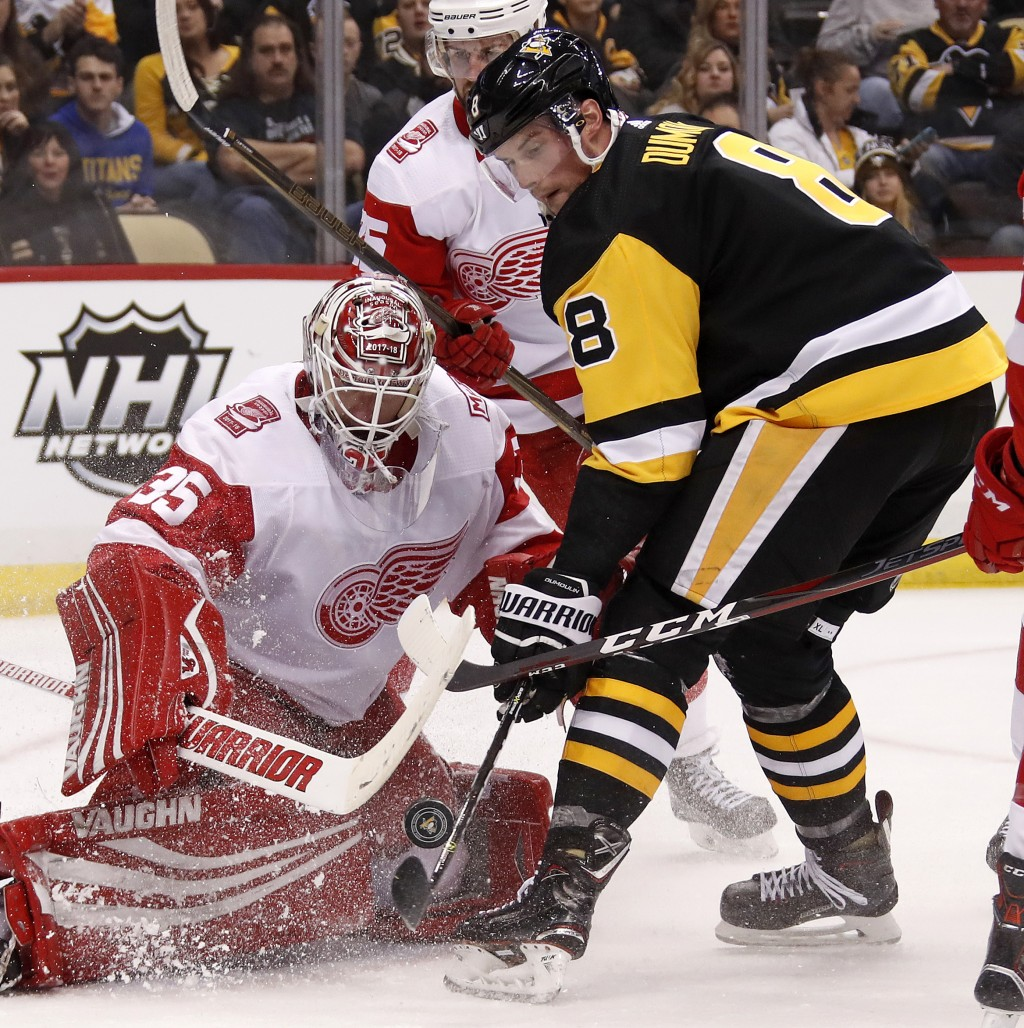 Pittsburgh Penguins' Brian Dumoulin (8) can't get his stick on a rebound in front of Detroit Red Wings goaltender Jimmy Howard (35) in the second peri