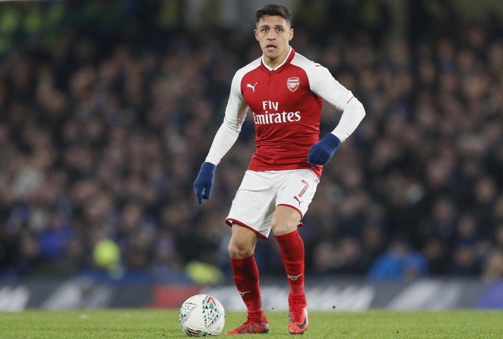 FILE - In this file photo dated Wednesday, Jan. 10, 2018, Arsenal's Alexis Sanchez during the English League Cup semifinal first leg soccer match betw