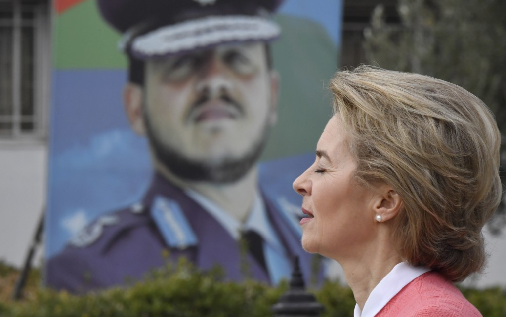 German Defence Minister Ursula von der Leyen walks past a portrait of Jordan's King Abdullah II as she heads to a ceremony handing over equipment to J