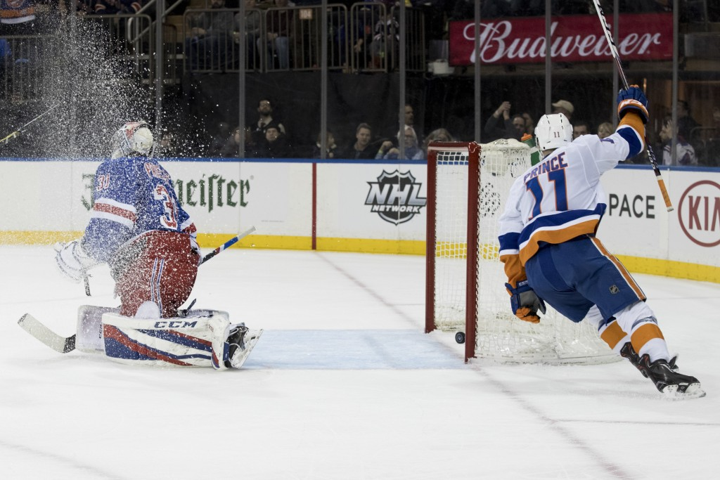 New York Islanders left wing Shane Prince (11) reacts after scoring a goal past New York Rangers goaltender Ondrej Pavelec (31) during the first perio