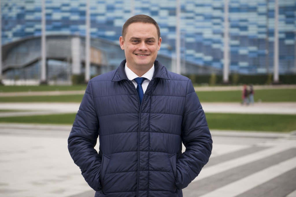 In this photo taken on Friday, Jan. 12, 2018, deputy mayor of Sochi Sergei Yurchenko stands in front of the Iceberg arena in the Olympic Park in Sochi