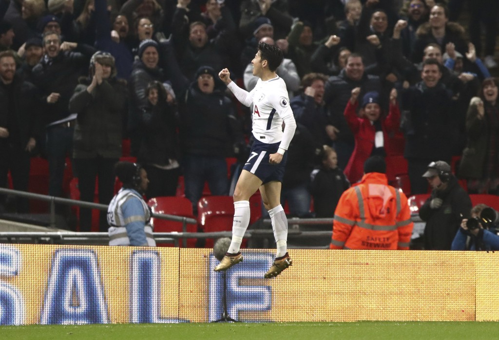Tottenham Hotspur's Son Heung-Min celebrates scoring his side's first goal of the game during the English Premier League soccer match at Wembley Stadi