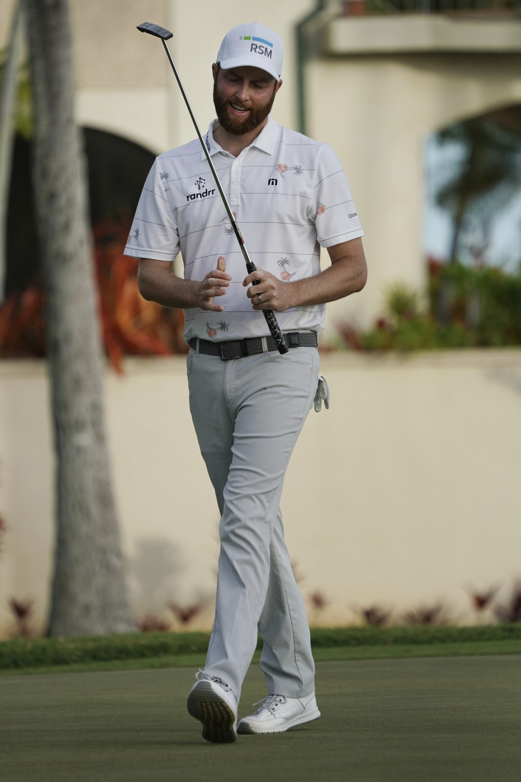 Chris Kirk reacts to his putt on the 16th green during the third round of the Sony Open golf tournament, Saturday Jan. 13, 2018, in Honolulu. (AP Phot