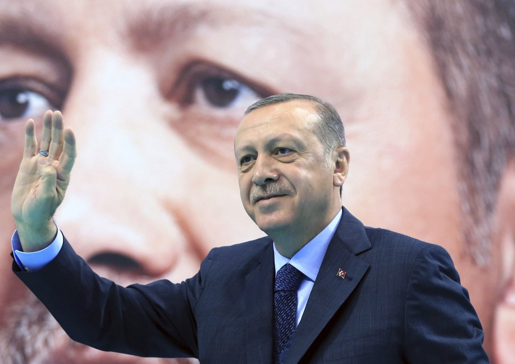 Turkey's President Recep Tayyip Erdogan waves to supporters of his ruling Justice and Development Party (AKP), at a rally in Elazig, eastern Turkey, S
