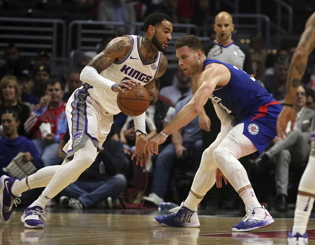 Sacramento Kings center Willie Cauley-Stein, left,  drives as Los Angeles clippers forward Blake Griffin, right, defends in the first period of an NBA
