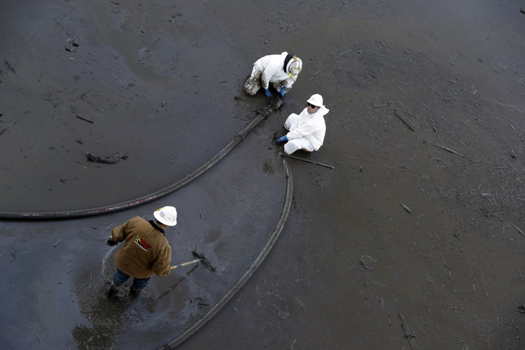 Crews pump mud out of southbound Highway 101 Saturday, Jan. 13, 2018, in Montecito, Calif.  Most of the people of Montecito, a town usually known for