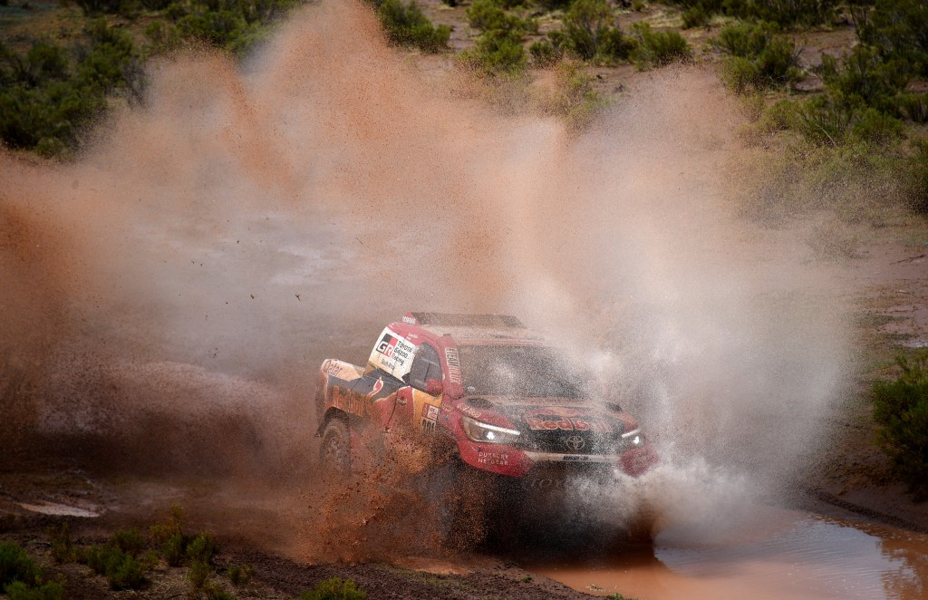 Driver Nasser Al-Attiyah, of Qatar, and co-driver Matthieu Baumel, of France, race their Toyota during stage 7 of the 2018 Dakar Rally between La Paz