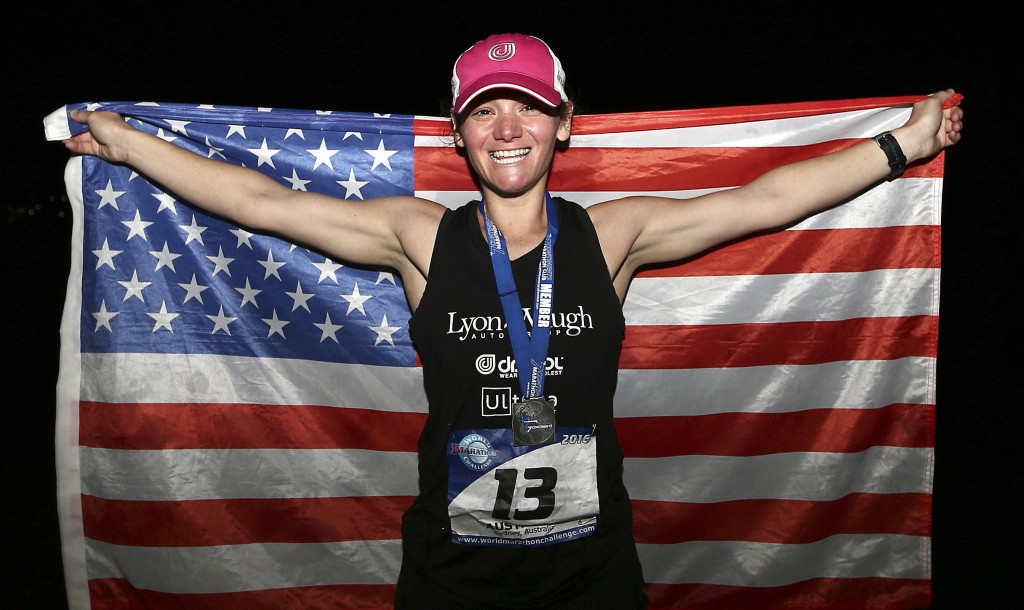FILE - In this Jan. 30, 2016 file photo, Becca Pizzi of the United States, holds an American flag after winning the seventh and final leg of the World