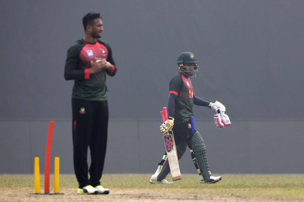 Bangladesh cricketer Mushfiqur Rahim, right, walks back from the net, as Shakib Al Hasan prepares to bowl during a training session ahead of the Tri-N
