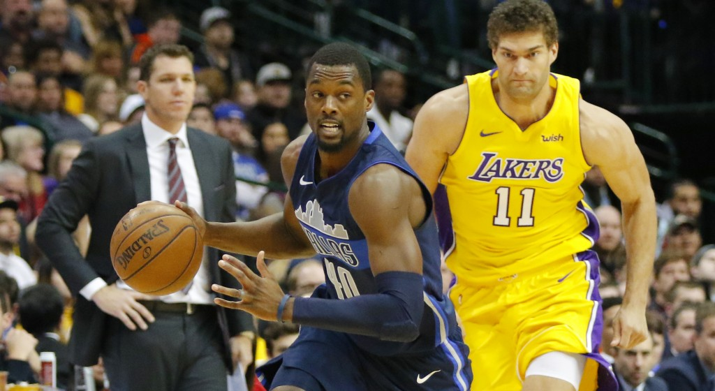 Dallas Mavericks forward Harrison Barnes (40) steals the ball as Los Angeles Lakers center Brook Lopez (11) chases him in the first half of an NBA bas