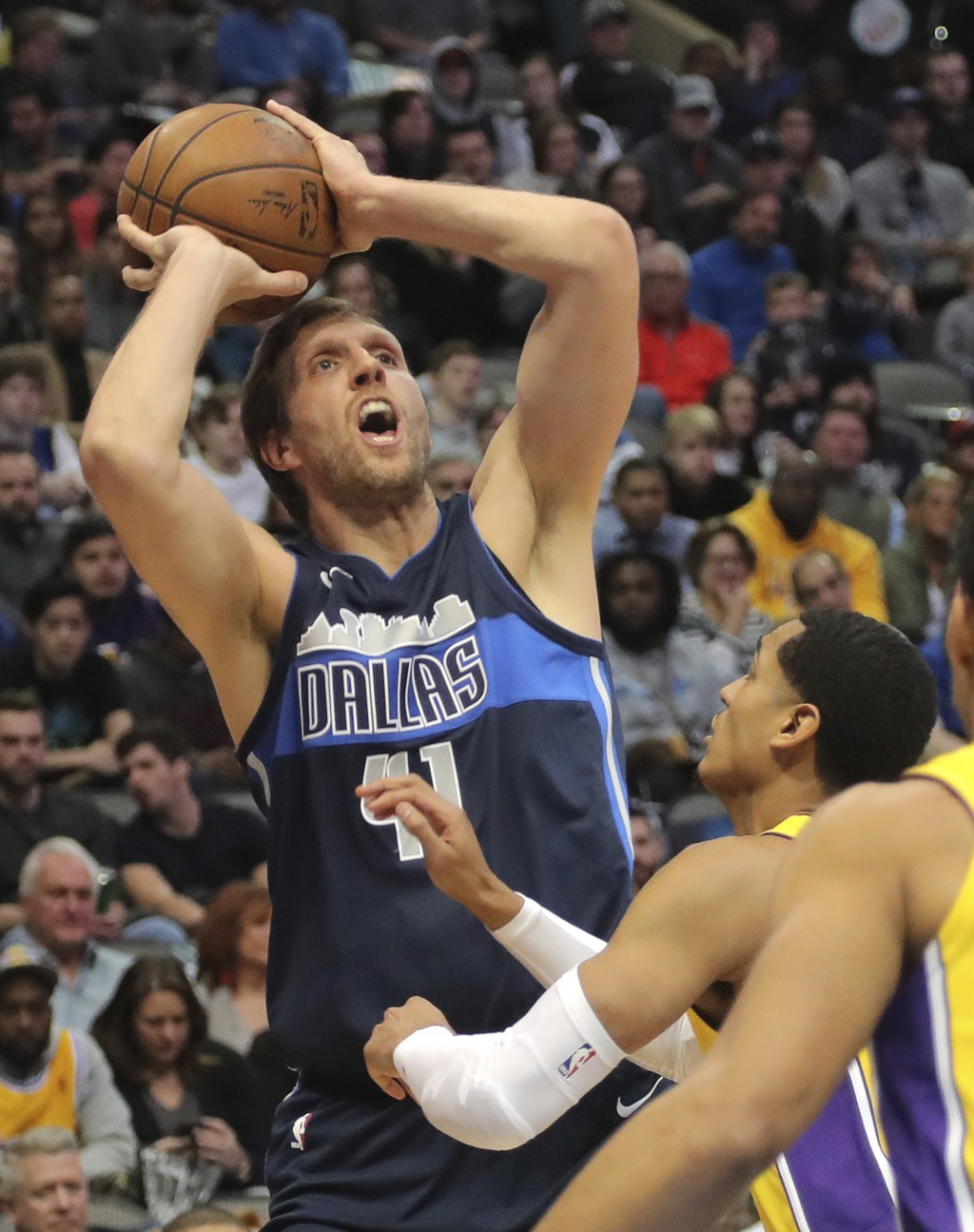 Dallas Mavericks forward Dirk Nowitzki (41) shoots in the first half of an NBA basketball game against the Los Angeles Lakers at American Airlines Cen